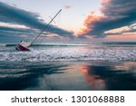Sunken Sailboat On Shallow...