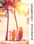 surfboard and palm tree on... | Shutterstock . vector #1301089045