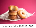 donuts with icing on pink... | Shutterstock . vector #1301181505