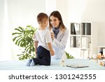 female doctor working with cute ... | Shutterstock . vector #1301242555