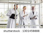 group of chemists working in a... | Shutterstock . vector #1301458888