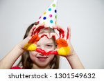 girl in a cap  shows palms in... | Shutterstock . vector #1301549632
