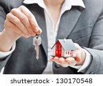 real estate agent with house... | Shutterstock . vector #130170548
