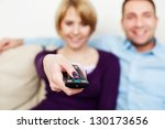 Young couple watching tv - stock photo
