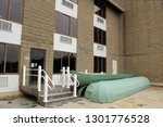 exterior of an abandoned and...   Shutterstock . vector #1301776528