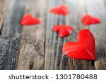 red hearts on old wooden planks | Shutterstock . vector #1301780488