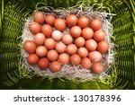 Easter eggs in  natural eco wicker basket - stock photo