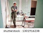 room repair. young builder in a ...   Shutterstock . vector #1301916238