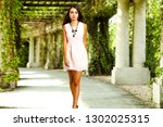 woman in pink dress and spring... | Shutterstock . vector #1302025315