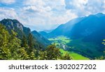 alps with clouds and sun | Shutterstock . vector #1302027202