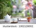 white kettle and cup with and...   Shutterstock . vector #1302128002