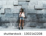 a dazzling young african... | Shutterstock . vector #1302162208