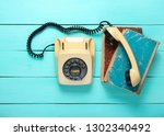 retro rotary telephone on a... | Shutterstock . vector #1302340492