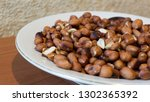 roasted peanuts snack in white... | Shutterstock . vector #1302365392
