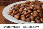 roasted peanuts snack in white... | Shutterstock . vector #1302365395