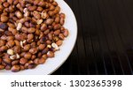 roasted peanuts snack in white... | Shutterstock . vector #1302365398