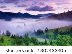 mountains and forest in the fog.... | Shutterstock . vector #1302433405