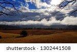dramatic late autumn cloudscape | Shutterstock . vector #1302441508
