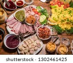 Stock photo scandinavian smorgasbord with an assortment of cold cuts herring sauces and scrambled eggs 1302461425