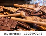 brussels chocolate with nuts...   Shutterstock . vector #1302497248