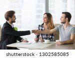 happy clients couple handshake... | Shutterstock . vector #1302585085