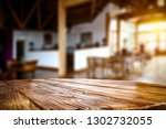 desk of free space and blurrred ... | Shutterstock . vector #1302732055