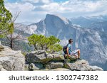 young man sitting on the very... | Shutterstock . vector #1302747382