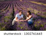 couple in love on lavender... | Shutterstock . vector #1302761665
