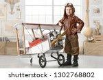 little boy in a pilot's suit... | Shutterstock . vector #1302768802