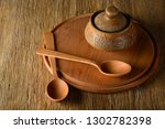 wooden spoon  plate  clay pot... | Shutterstock . vector #1302782398
