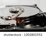 detail from an opened hard disk | Shutterstock . vector #1302802552