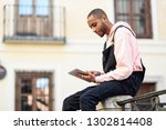 young black man using digital... | Shutterstock . vector #1302814408