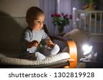 little baby boy  sitting in... | Shutterstock . vector #1302819928
