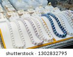 pearl jewelry in store. thai... | Shutterstock . vector #1302832795