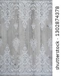 the texture of lace on wooden...   Shutterstock . vector #1302874378