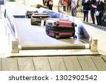 baggage luggage on conveyor... | Shutterstock . vector #1302902542