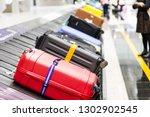 baggage luggage on conveyor... | Shutterstock . vector #1302902545