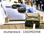baggage luggage on conveyor... | Shutterstock . vector #1302902548