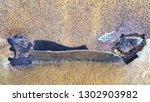 bent edge of old rusty metal... | Shutterstock . vector #1302903982
