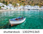 fishing boat and the scenic... | Shutterstock . vector #1302941365