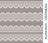 set of white lace borders on a... | Shutterstock .eps vector #1302968362