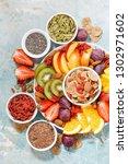 plate of fresh seasonal fruits...   Shutterstock . vector #1302971602