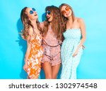 three young beautiful smiling... | Shutterstock . vector #1302974548