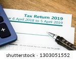 uk hmrc self assessment income...   Shutterstock . vector #1303051552