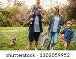 happy family with dog walking... | Shutterstock . vector #1303059952