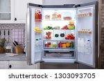 An Open Refrigerator Filled...