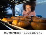 close up of a smiling young... | Shutterstock . vector #1303107142
