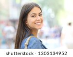 portrait of a happy teenage... | Shutterstock . vector #1303134952