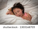 girl sleeping with teddy bear | Shutterstock . vector #1303168705