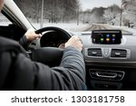 the young man is driving on his ...   Shutterstock . vector #1303181758